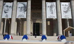 Francois Hollande (centre) stands on the Pantheon steps between the flag-draped coffins of Jean Zay, Genevieve de Gaulle-Anthonioz, Pierre Brossolette and Germaine Tillion.