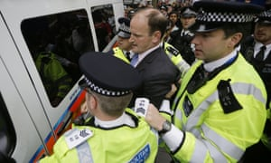 Douglas Carswell is helped into a police van for his own safety in central London on Wednesday.