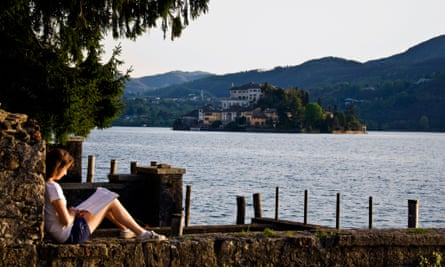 Young woman student reading by Lake Orta at San Giulio