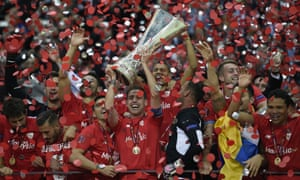 Sevilla players celebrate with trophy.