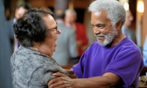 Neb. state Sen. Ernie Chambers, right, of Omaha, celebrates with Sen. Kathy Campbell, left, of Lincoln, after the one-house Legislature voted 30-19 to override Gov. Pete Ricketts, a Republican who supports the death penalty.