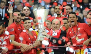 Sevilla Players celebrate with the trophy at the end of their 3-2 victor over FC Dnipro Dnipropetrovsk.