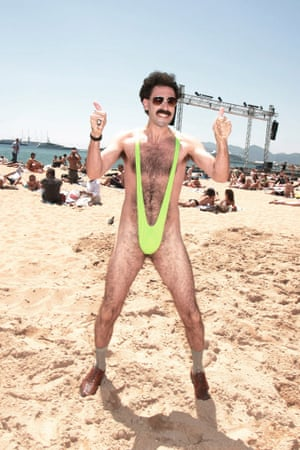 Sacha Baron Cohen as Borat gives a thumbs up on a beach in his mankini in Cannes, France.