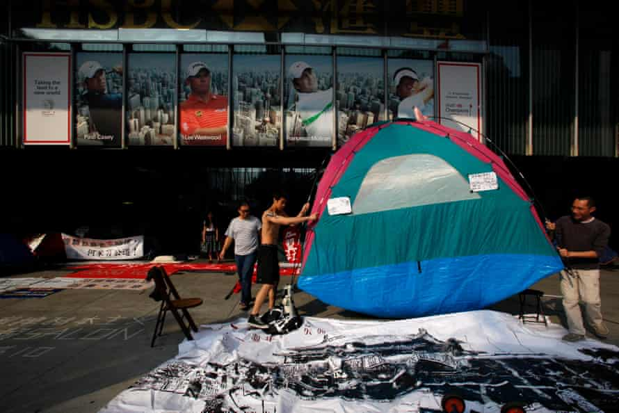 """Protesters move a tent during the """"Occupy Central"""" campaign, which began in October 2011."""