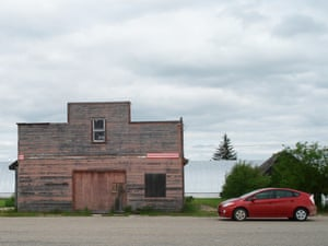 Stopping to photograph and old wooden building near Pipestone, Manitoba.