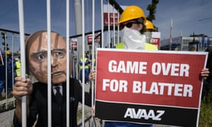 A demonstrator wearing a Sepp Blatter mask takes part in a protest against the condition of workers in Qatar, on the sidelines of the 65th Fifa Congress on May 28, 2015 in Zurich.