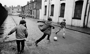 Boys Playing Football In The Backstreets Of Manchester