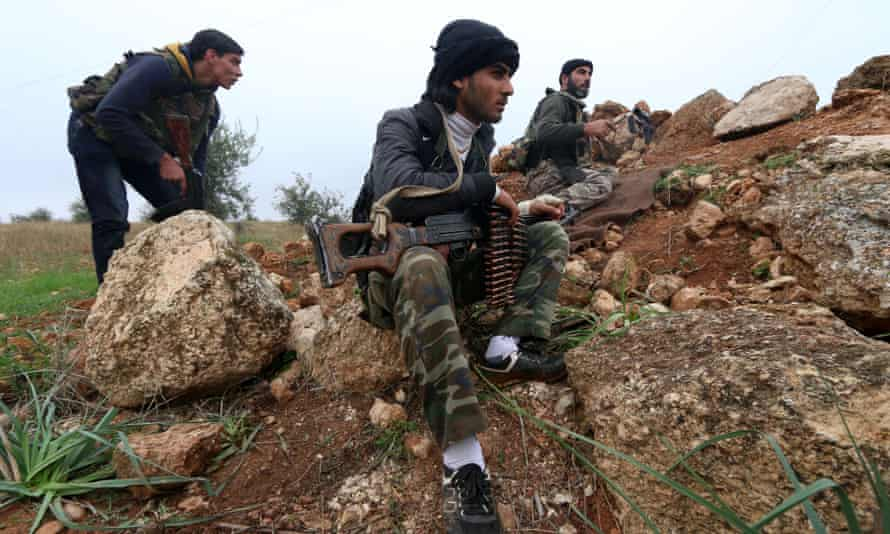 Fighters from the Al-Nusra Front fight against forces loyal to Assad  outside Aleppo.
