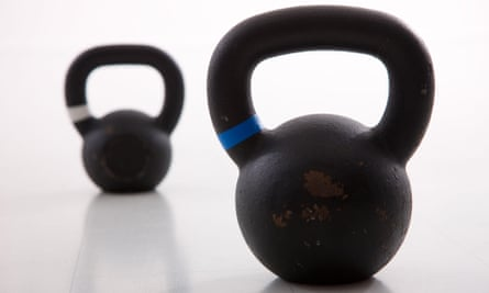 Kettlebells weights in a workout gym. Pure Gym is buying LA Fitness.