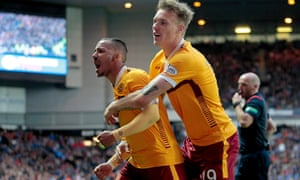 Lionel Ainsworth celebrates with Lee Erwin after scoring the third goal for Motherwell.