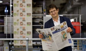 Rusbridger with the first copy of the new Berliner-format Guardian in September 2005.