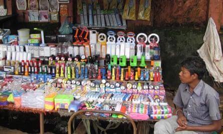 Roadside vendor selling battery torches