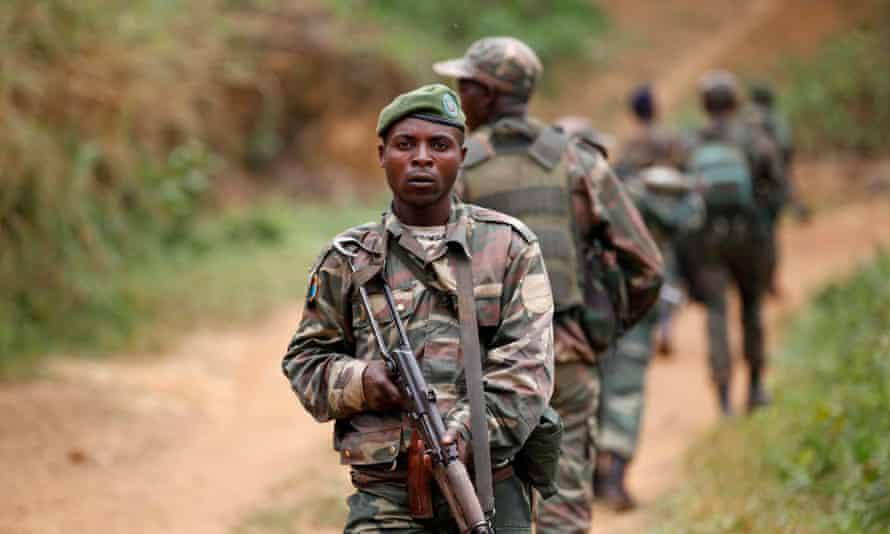 DRC military personnel patrol against rebel groups near Beni in North Kivu province.
