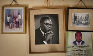 Family portraits, including one of Barack Obama's father (also called Barack) hang in Kogelo, western Kenya.