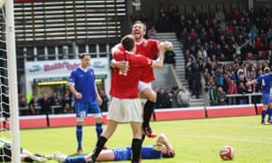 FC United striker Tom Greaves scores the first goal at their new ground, Broadhurst Park, in a test event on 16 May.