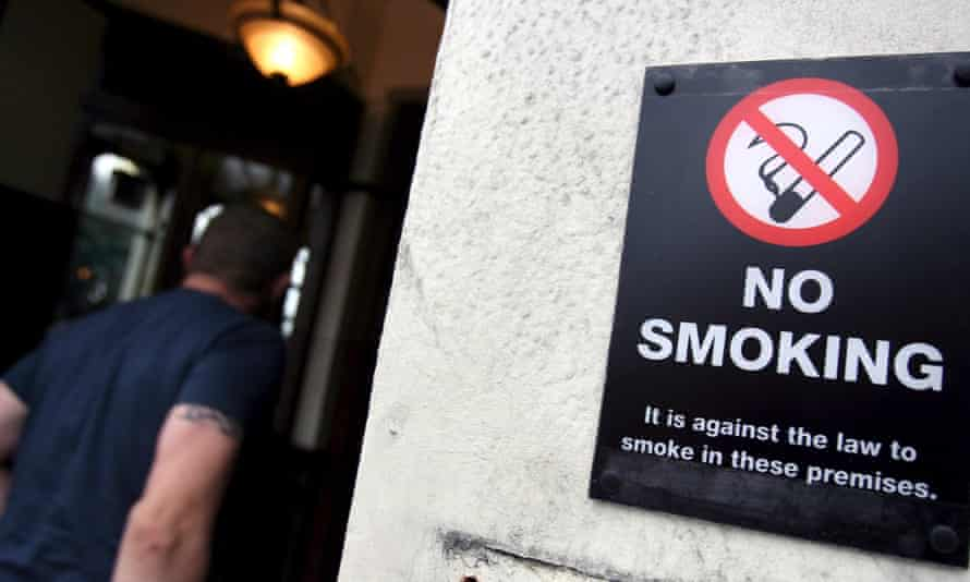 """A customer enters a pub that is enforcing a no smoking on its premises in London. Hazel Cheeseman, policy director at Ash, said:  """"Helping people to quit smoking is one of the most cost effective healthcare interventions and helps to save both lives and money."""""""