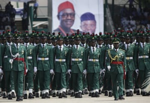 Soldiers parade in the green and white of Nigeria at Muhammadu Buhari's inauguration.