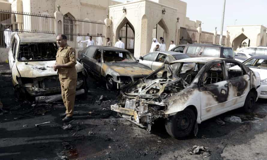 A policeman carries out an inspection after the explosion at the al-Anoud mosque