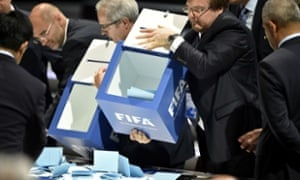 Officials open ballot boxes amid vote counting for the Fifa presidency.