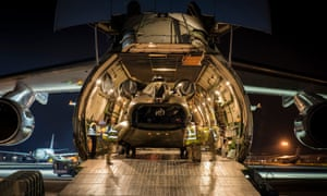 A RAF Chinook helicopter carrying emergency supplies being loaded on to a cargo aircraft to help the rescue effort in Nepal.