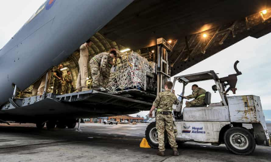 Military police from the British Royal Air Force (RAF) help to unload UK aid for Nepalese earthquake victims from an RAF C-17 aircaft after it landed in Kathmundu.