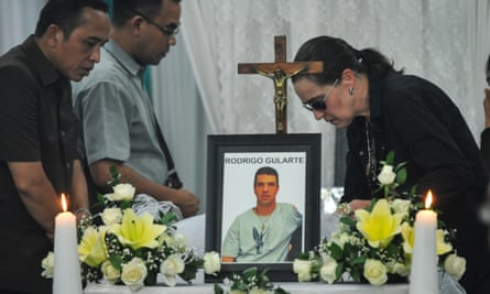 Angelita Muxfedlt, right, a cousin of Brazilian Rodrigo Gularte, by his coffin in Jarkarta on 29 April. Gularte is to be buried in Brazil on 3 May.