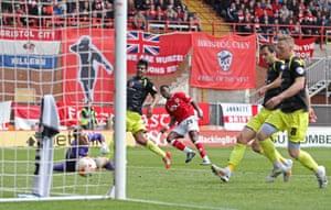 Kieran Agard scores their third goal.
