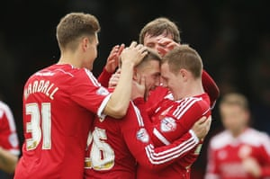 Anton Rodgers of celebrates with team mates after scoring their first.