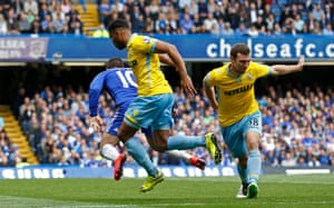 Eden Hazard is brought down in the area by James McArthur.