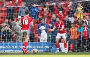 Conor Hourihane celebrates with Rhys Oates after scoring the fourth goal for Barnsley.