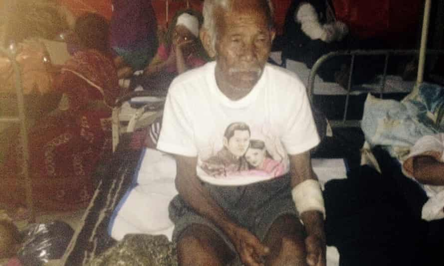 Funchu Tamang, 101, sits on a bed in a hospital after being pulled alive from the rubble left by the Nepali earthquake.