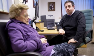 Dr Guy Wilkinson seeing patients in his consulting room in Glossop, Derbyshire.