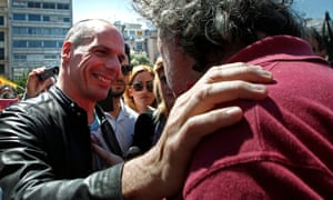 Greek finance minister Yanis Varoufakis talks with a protester in a demonstration during a May Day rally. He continues to enjoy widespread support, despite a lack of progress from Syriza.