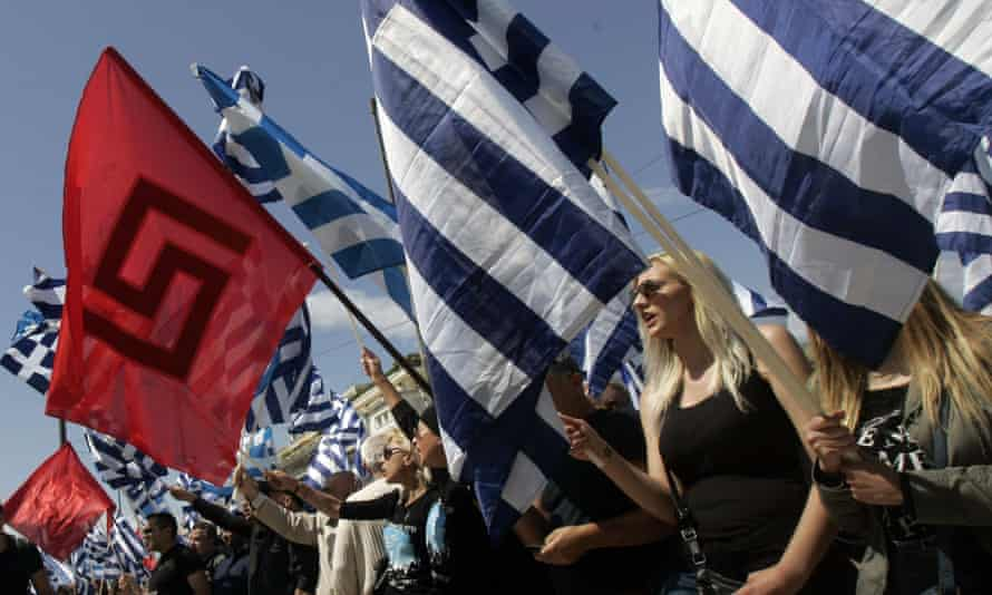 Golden Dawn supporters hold the party flag and Greek national flags during a rally in Athens last year. The neo-Nazi party is Greece's third biggest political force, and has accused Tsipras of submitting to Merkel.