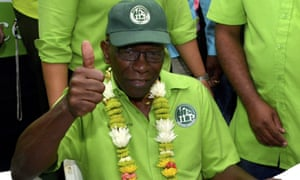 The former Fifa vice-president Jack Warner giving a thumbs-up at a political meeting after his release from prison in Trinidad and Tobago.