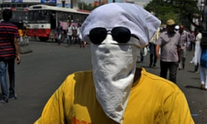 A man covers his head in Hyderabad