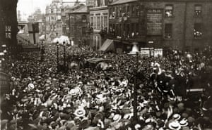 Vast crowds fill the streets of Burnley as they welcome home their team after defeating Liverpool 1-0 to win the Cup for the first time. The trophy was presented to captain Tommy Boyle by King George V, the first time a reigning monarch had attended the final.