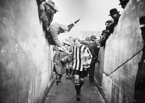 <strong>1924 Newcastle United v Aston Villa </strong> Magpies full back Frank Hudspeth carries the trophy down the tunnel after Newcastle's 2-0 win