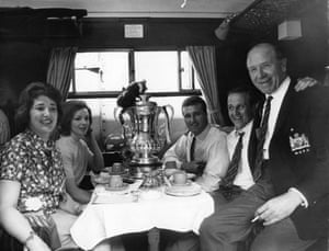 <strong>1963 Leicester City v Manchester United</strong> Members of the United team in their train carriage before leaving London for Manchester, after their 3-1 victory. Right to left: manager Matt Busby, Maurice Setters, captain Noel Cantwell and the players' wives