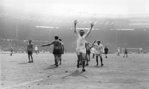 """<strong>1968 West Bromwich Albion v Everton</strong> Jeff Astle raises his arms in celebration after firing the ball through the Everton defence in the third minute of extra-time to score the only goal of the game and win the cup for West Brom. Astle recalls: """"The ball came to my right foot at the edge of the box, I had a bash and duffed it, but this was my lucky day, Back it bounced from Colin Harvey's knees and I met it with my left, I saw this huge gap, the white net and the yellow ball streaking into the corner, Nothing else will ever be the same, nothing to match that moment."""""""
