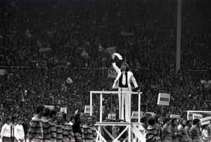 <strong>1972 Leeds United v Arsenal</strong> Pop star Tommy Steele conducts the singing during a ceremony to mark the 100th FA Cup final
