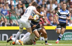 Anthony Watson of Bath Rugby is tackled by Owen Farrell of Saracens.