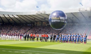 The teams line up before the kick-off.