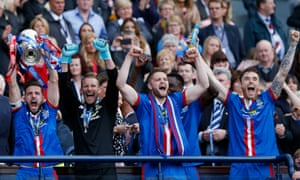 Inverness Caledonian Thistle's Graeme Shinnie lifts the trophy after winning the William Hill Scottish FA Cup final.