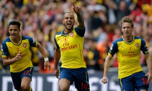 Theo Walcott and Arsenal celebrate going 1-0 ahead in the FA Cup final against Aston Villa.