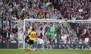 The ball swerves through the air and past Given to Arsenal's lead is doubled.