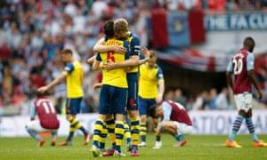 Arsenal's Per Mertesacker and Laurent Koscielny celebrate at the full time whistle ...