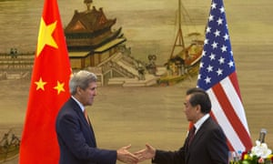 An uneasy relationship? US secretary of state John Kerry, left, and Chinese foreign minister Wang Yi shake hands after a press conference following meetings at the Ministry of Foreign Affairs in Beijing.