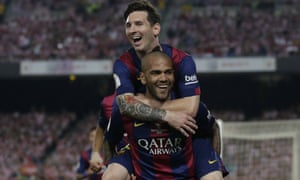 Lionel Messi celebrates with Dani Alves after scoring his side's third goal