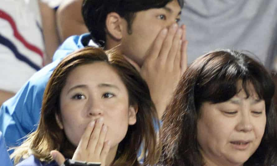 Soccer fans react to a strong earthquake in Japan